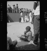 African American child waits for Watts Summer Festival to begin
