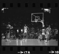Lew Alcindor plays defense for UCLA basketball in game against USC