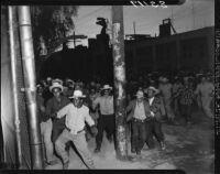 Rioting crowds of Mexican workers cross the U.S.-Mexico Border, Mexicali (Mexico)