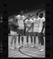 Lew Alcindor and Coach John Wooden huddle with UCLA freshman All-Americans