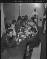 Undocumented Mexican workers eat a meal before deportation, Los Angeles, 1952
