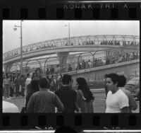 Chicano Moratorium Committee anti-war demonstrators cross pedestrian bridge
