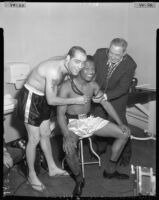 Sugar Ray Robinson receives physical exam before fight, Los Angeles, 1956