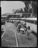 Undocumented Mexican workers board buses for deportation, Los Angeles, 1954