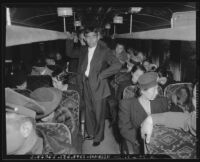 Japanese nationals on a bus during evacuation and relocation