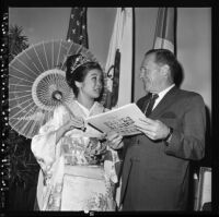Nisei Festival Week Queen speaks with Los Angeles Mayor Sam Yorty, Los Angeles, 1967