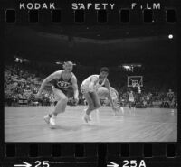 Lew Alcindor plays offense for UCLA basketball in game against USC