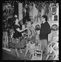Selling pinatas on Olvera Street, Los Angeles, 1968