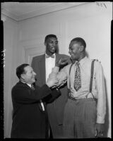 Abe Saperstein, Satch Paige, and Walter Dukes of the Harlem Globetrotters