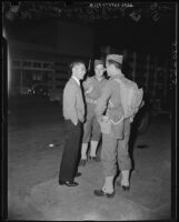 U.S. Army soliders talk to a civilian on Terminal Island (Calif.)