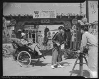 Rickshaw driver and passenger in Chinatown, Los Angeles (Calif.)