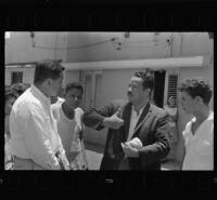 Ruben Salazar interviews civilians in Vietnam, 1965