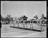 Rafer Johnson competes in the hurdles