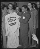 Henry Armstrong poses with World Featherweight Welterweight Champion robe
