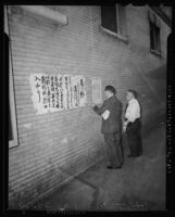 Reading reports of the Pearl Harbor attacks in Little Tokyo, Los Angeles, 1941