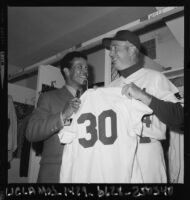 Walt Alston presents Maury Wills with Dodger uniform