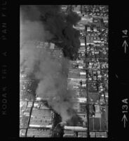 Aerial view of riots following Chicano Moratorium Committee antiwar protest, East Los Angles, 1970