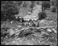 Chavez Ravine property owners examine bulldozed ruins
