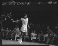 Richard Gonzales plays a tennis match