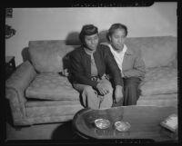 Demonstrators rest during a discriminatory housing protest, Los Angeles, 1945