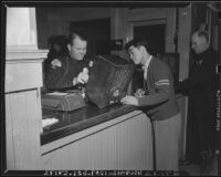 Japanese submit personal property to the Los Angeles Police Department, California, 1942