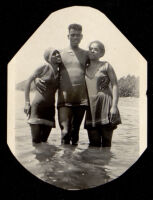 Young man and two women swimming, 1920s