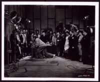 "Actors stage a scene from ""A House of Horror"" for prominent citizens on a sound stage at Hollywood Productions, Los Angeles, 1939"