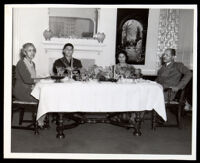 Drs. John and Vada Somerville dining with another couple, 1950s-1960s