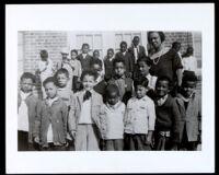 Bessie Bruington Burke with elementary school students, Los Angeles, 1918-1938