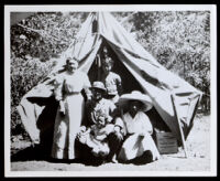 Family of 5 black Californians in front of a tent in a wilderness area, circa 1890-1910