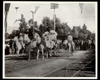 Four horse carriage carrying four young women at the Tournament of Roses parade, Pasadena, 1902