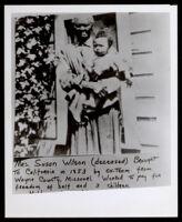 Susan Wilson holding a child, Oakland, circa 1880