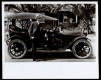 Police officer Frank White with his car in front of his home, Los Angeles, 1915-1925