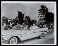 Mary Lee Franklin, winner of the Shrine Talent and Beauty Pageant, rides in a parade, Los Angeles, 1959
