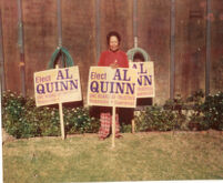 "Dorothy ""Dottie"" Quinn posing with an Elect Al Quinn election sign."