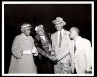 Drs. Vada and John Somerville and Gilbert Lindsay greet Daisy Lampkin at an airport, Los Angeles, 1954 (?)