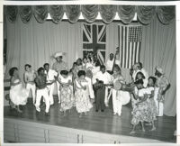 African Americans dancing on a stage with musicians, Los Angeles, 1940s-1950s