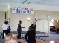 Dolores accepting LULAC Award