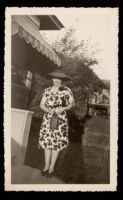 Woman standing in front of a house, 1940s-1950s