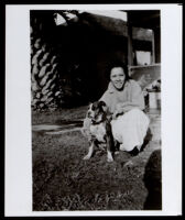 Nelle Johnson, aunt of Ralph Bunche with a dog at home, Los Angeles, circa 1919
