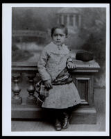 African American toddler next to a banister, 1870-1900
