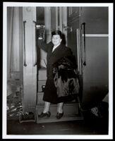 Charlotta Bass boarding a train en route to Washington, D.C., Los Angeles, 1952 (?)