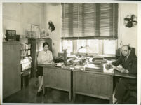 Cynthiabelle Gordon Smith and a male coworker in an office of the U.S. Public Health Service, Washington, D.C.,1939