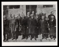 African American men standing in front of a brick church (?) building, undated