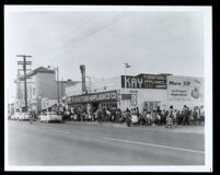 Children in a long line at the Largo movie theater on East 103rd St., Los Angeles, 1960