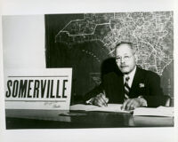 Dr. John A. Somerville seated in an office when he was running for City Council candidate, Los Angeles, 1960s (?)