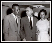 Ralph Bunche with an unidentified man and woman, 1958