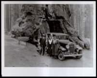 Titus Alexander with his wife, Mary Alexander at the Wahwona Tree, Yosemite National Park, 1920-1930