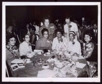 Past western regional directors of Delta Sigma Theta Sorority at a banquet event with Miriam Matthews and 7 others, Los Angeles, 1972