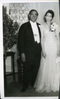 Dr. Wilbur Clarence Gordon and Cynthia Mitchell Gordon on their wedding day at the Somerville home, Los Angeles, 1944-1945